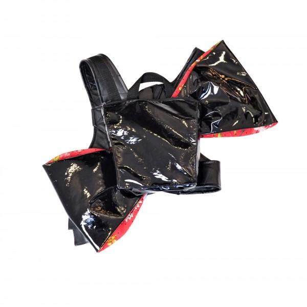 Black laquered faux leather transformer backpack with shoulder belts