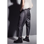 Black faux leather pants with grey insert