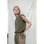 Green top with shoulder pads