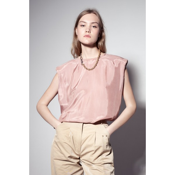Light pink top with shoulder pads